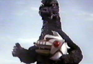 Godzilla takes Mechagodzilla's head - The Terror of Godzilla (Mekagojira no gyakushu)